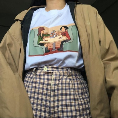 a graphic t-shirt with Daria and Jane from the show Daria