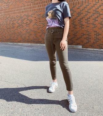 degrassi drake t-shirt, olive green belted pants, adidas rose gold superstars