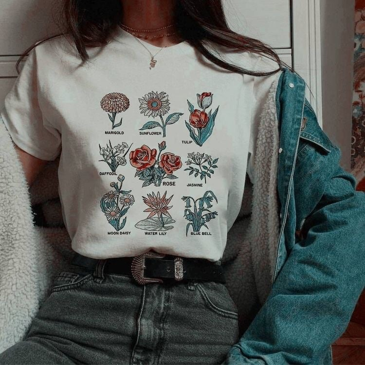 a graphic tee with flowers on it