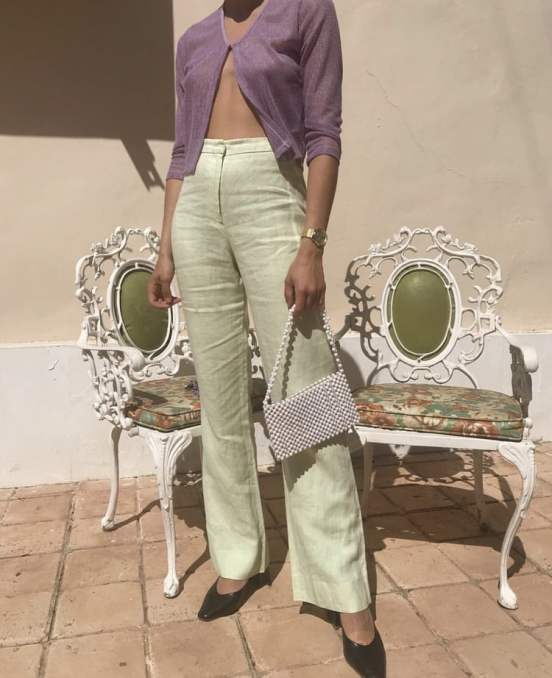 light green jeans or pants with a light purple cardigan