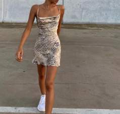 a snakeskin dress paired with chunky sneakers