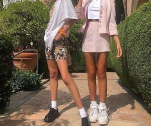 A summer skirt (right) and shorts (left) paired with sneakers