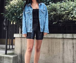 biker shorts styled casually with a denim jacket