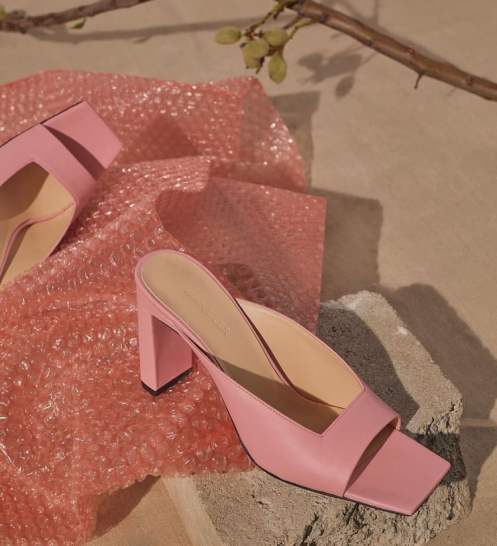 pink mules on a sandy beach