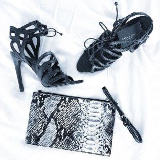 An animal print clutch and strappy heels