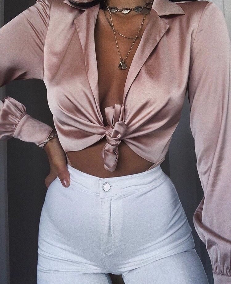 a pink silk shirt